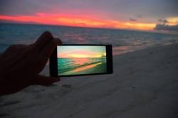 focení západu slunce na pláži